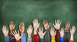 hands raised chalkboard