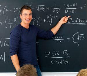 stockfresh 42800 teacher pointing at blackboard teaching mathematics sizel
