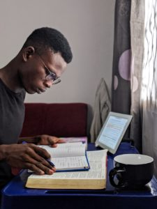 male student studying alone